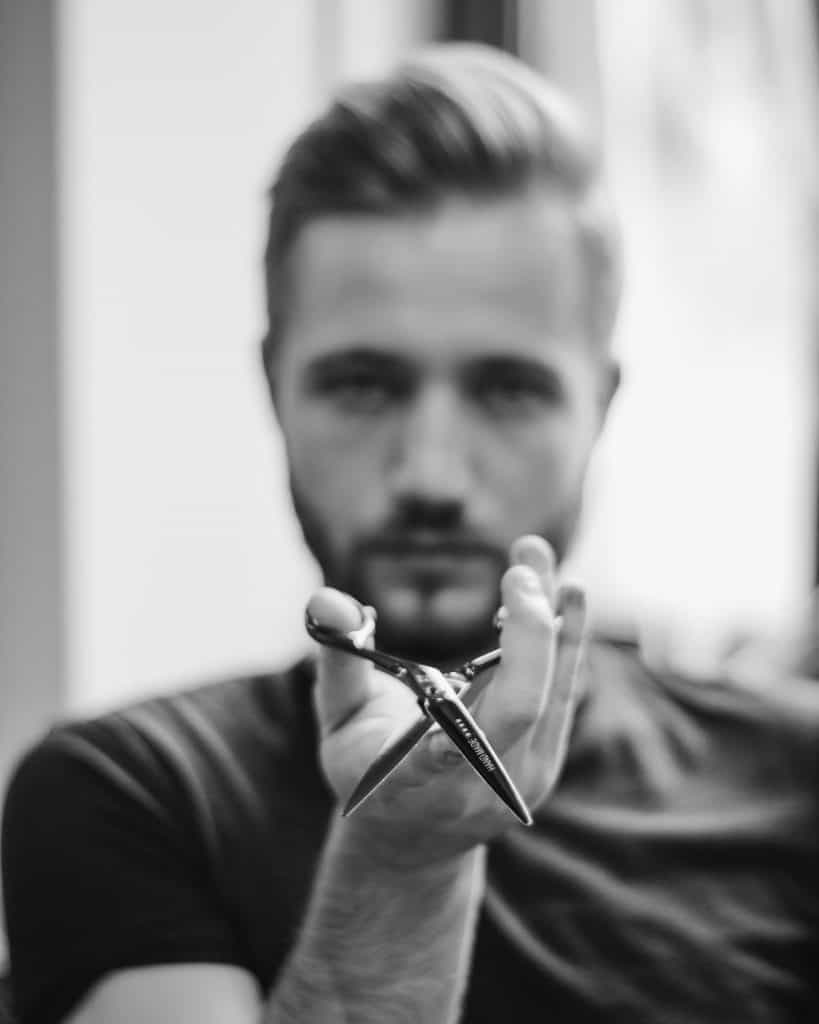 barber with scissors